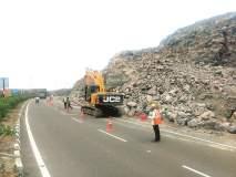 पुणे-नाशिक महामार्गावर धोकादायक दगड काढण्याचे काम सुरू