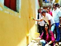 आयुक्तांनी पत्नीसोबत रंगवल्या भिंती