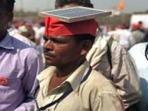 Kisan Long March : शेतकऱ्याची अशीही सेवा, सोलार पॅनल डोक्यावर घेऊन तो झाला मोर्चेकऱ्यांचा 'मोबाइल चार्जर'