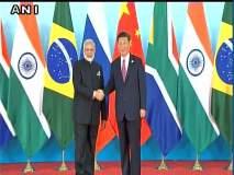 ब्रिक्स शिखर परिषद : चीनचे राष्ट्राध्यक्ष क्षी जिनपिंग यांनी पंतप्रधान मोदींचं इंटरनॅशनल कॉन्फरन्स सेंटरमध्ये केलं स्वागत