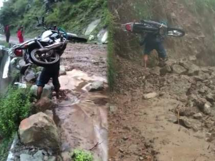 Himachal Pradesh rain landslide Babubali video viral | बाबो! रस्त्यावर मलबा...बाजूला खोल दरी...खांद्यावर बाइक घेऊन 'बाहुबली'ने रस्ता केला पार...