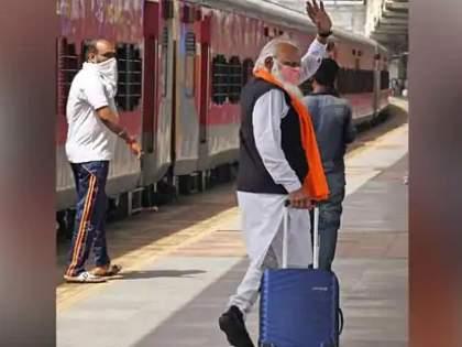 Mumbai Viral News lalaji devaria resembles PM Narendra Modi waves at dadar station   हातात बॅग घेऊन पंतप्रधान 'मोदी' ट्रेननं कुठे निघाले...? आपणही फसलात ना...?