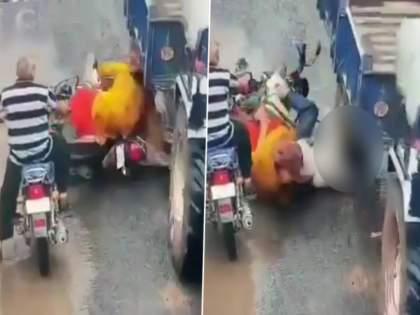 gujarat accident video bike rider survives even after wheel of tractor trolley mounted on the head   VIDEO: तो दुचाकीवरून पडला; डोक्यावरून गेलं ट्रॅक्टरच्या ट्रॉलीचं चाक अन् मग घडला चमत्कार