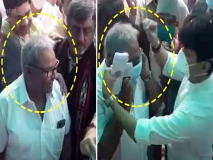 Union minister Jyotiraditya Scindia gives his used mask to a person to wear bizarre video goes viral | ...अन् केंद्रीय मंत्री सिंधियांनी स्वत:चा मास्क माजी मंत्र्याला घातला; व्हिडीओ व्हायरल