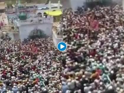 VIDEO In UP's Badaun, Covid-19 norms go for a toss as hundreds turn out for funeral of Islamic leader | Video - कोरोना नियमावलीची एैशीतैशी अन् सोशल डिस्टंसिंगचा फज्जा; मुस्लिम धर्मगुरुच्या अंत्ययात्रेसाठी तुफान गर्दी