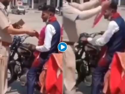 Viral : Police congratulate to newly married couple for following covid protocols video viral | Viral : लॉकडाऊनमध्ये नवं जोडपं बुलेटवर फिरायला निघालं; पोलिसांनी अडवताच झालं असं काही..., पाहा व्हिडीओ