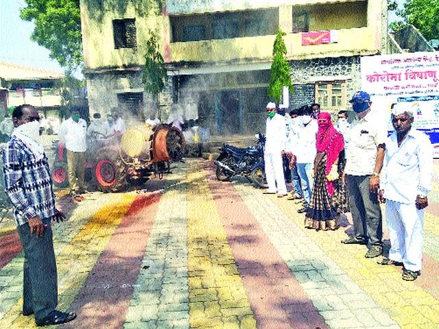 Disinfection spraying at Devgaon   देवगाव येथे जंतुनाशक फवारणी