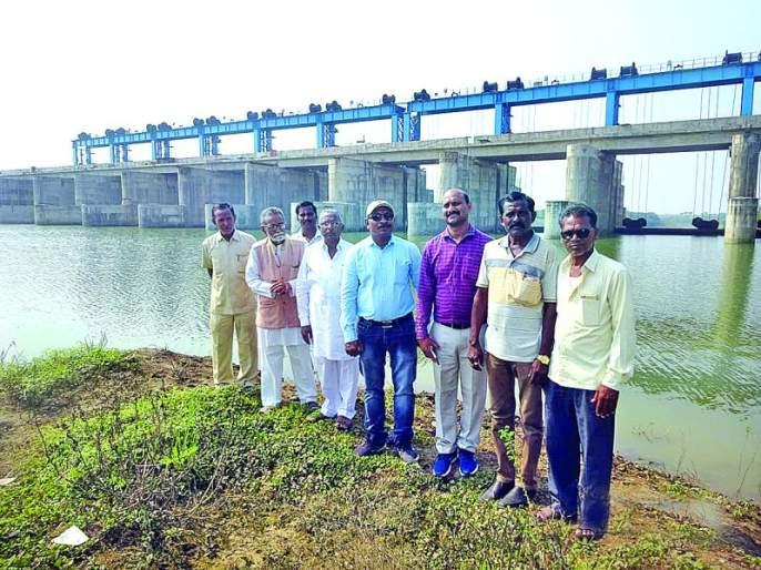 Water Resources in Ner-Dhamana Barrage; Irrigation Conflict Committee worship | नेर-धामणा बॅरेजमध्ये जलसंचय; जलसिंचन संघर्ष समितीने केले जलपूजन