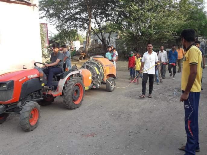 Disinfectant spraying here at Deshmane   देशमाने येथे जंतूनाशक फवारणी