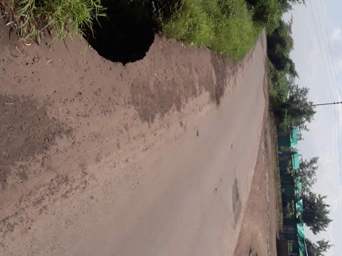 The road from Akrale to Janori is covered with potholes   अक्र ाळे ते जानोरी रस्ता खड्ड्यांनी व्यापला