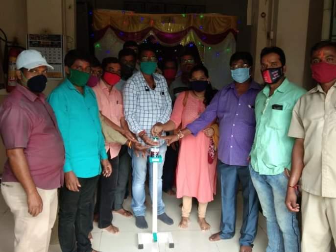Sanitizer stand in Ganeshotsav, offering of vitamin tablets   महावितरण कंपनीचे गणेशोत्सवात सॅनिटायझर स्टॅन्ड वाटप