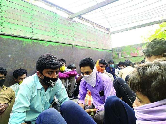 Corona: 35 laborers traveling to Rajasthan hiding in a truck | कोरोना : राजस्थानकडे जाणाऱ्या ३५ मजुरांचा ट्रकमध्ये लपुन प्रवास