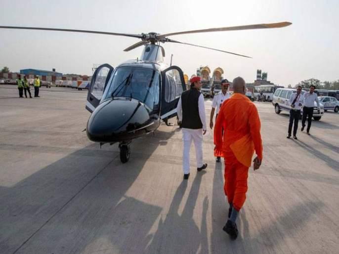 lok sabha election 2019 who is this yogi adityanath look alike in akhilesh yadavs plane | अखिलेश यांनी प्रचारात आणले योगी आदित्यनाथांचे 'डुप्लिकेट', काढतील का भाजपाची विकेट?