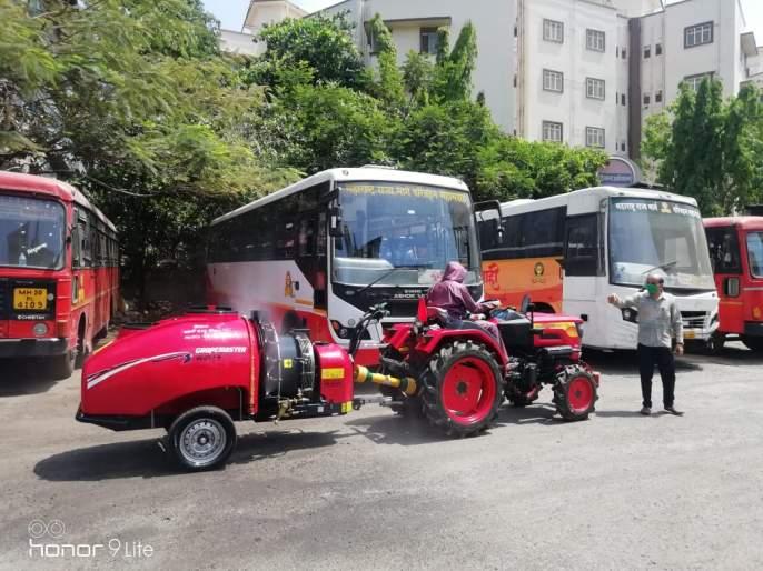 Sanitizer sprayer by Mumbai Central Depot Tracker, ST | एसटीच्या मुंबई सेंट्रल डेपोत ट्रॅकरद्वारे सॅनिटायझर फवारणी