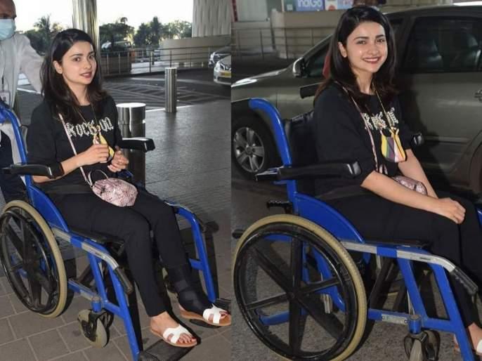 Prachi Desai was seen in a wheelchair at the Mumbai airport   मुंबई एअरपोर्टवर प्राची देसाई दिसली व्हीलचेअरवर, फोटो पाहून चाहत्यांना बसला धक्का