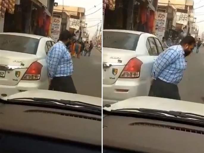 Video : Punjabi guy lifting car as it was parked on the middle of the road | Video : रस्त्याच्या मधेच पार्क केली होती कार, बघा पंजाबातील या 'बाहुबली' ने काय केलं असेल?
