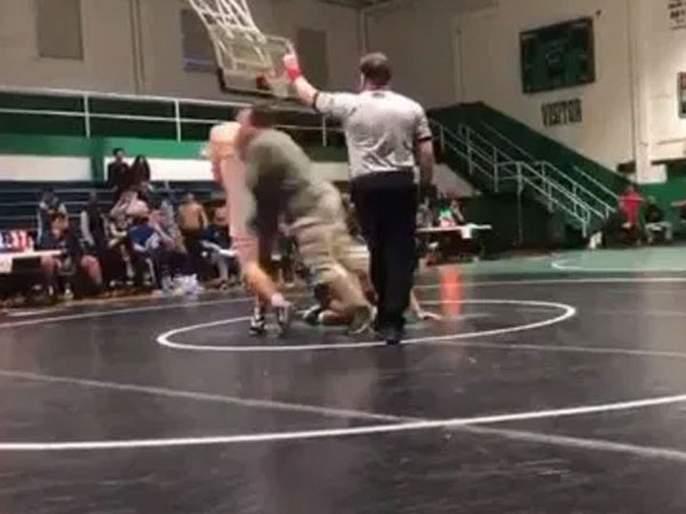 Father tackles sons opponent at high school wrestling match video goes viral   Video : ज्याने मुलाला कुस्तीत हरवलं त्याला पप्पाने धुतलं, व्हिडीओ झाला व्हायरल!