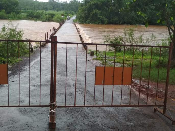 Salgaon dam under water in Ajra taluka   आजरा तालुक्यातील साळगाव बंधारा पाण्याखाली