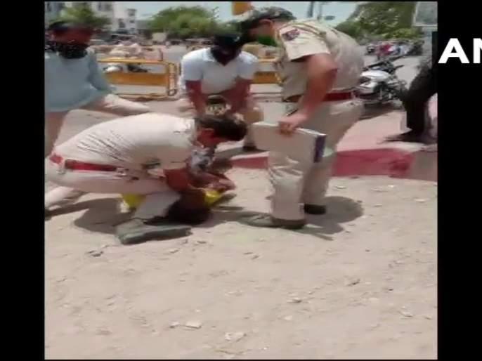 Video: Police in Jodhpur give legs to neck for not wearing mask; Netizens remember George Floyd | Video : मास्क घातला नाही म्हणून जोधपूरमधील पोलिसाने दिला गळ्यावर पाय; नेटिझन्सना आठवला जॉर्ज फ्लॉईड