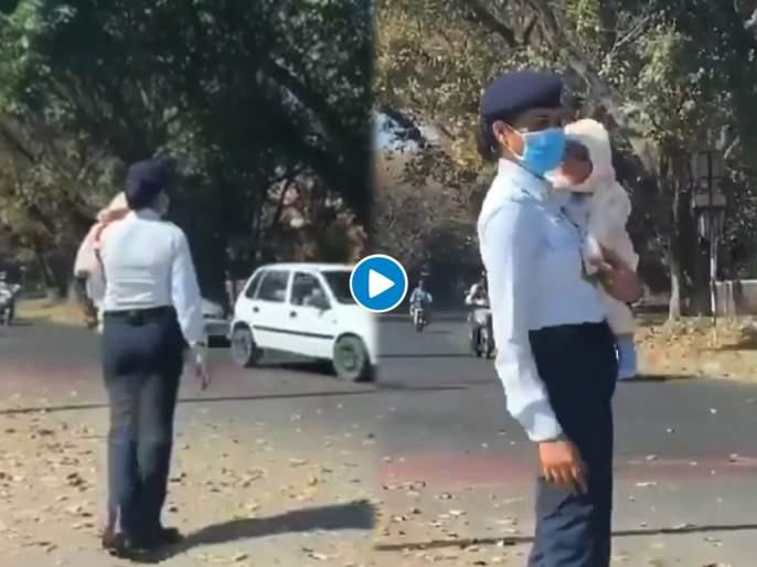 Female traffic police officer on duty with her new born baby video went viral chandigarh | Traffic police on duty with her baby : सॅल्यूट! डोक्यावर रणरणतं ऊन, कुशीत चिमुकल्याला घेऊन कर्तव्यावर हजर झाली खाकीतली माऊली