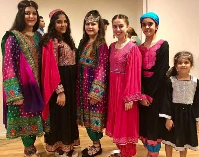Afghan women protest Taliban's hijab diktat by sharing photos in colourful dresses | Afghan women protest Taliban's hijab diktat by sharing photos in colourful dresses