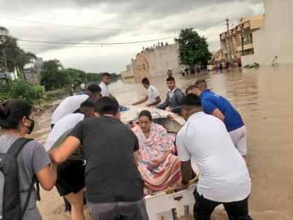 Indian Navy team deployed to assist flood relief ops in Rajkot | Indian Navy team deployed to assist flood relief ops in Rajkot