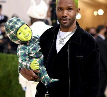 Met Gala 2021: Frank Ocean carries green robotic baby on the red carpet | Met Gala 2021: Frank Ocean carries green robotic baby on the red carpet