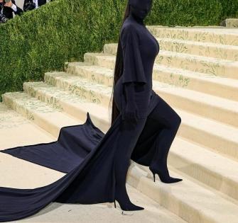 Met Gala 2021: Kim Kardashian's black faceless full-body suit has a Kanye West connect   Met Gala 2021: Kim Kardashian's black faceless full-body suit has a Kanye West connect
