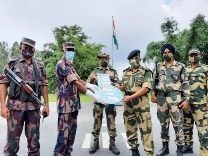 India-Bangladesh border forces exchange sweet, greet on Eid-al-Adha | India-Bangladesh border forces exchange sweet, greet on Eid-al-Adha