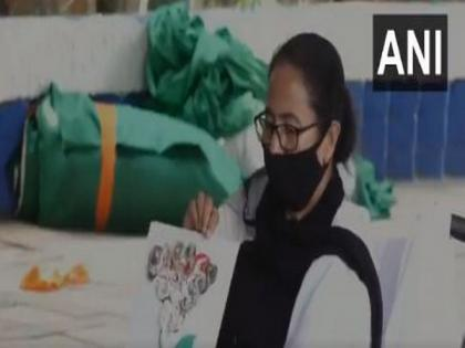 On dharna against EC's campaign ban, Mamata takes to painting | On dharna against EC's campaign ban, Mamata takes to painting