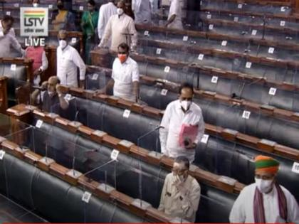 Government introduces two bills in LS, opposition continues with its protest | Government introduces two bills in LS, opposition continues with its protest