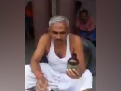 Giving demonstration on camera, BJP MLA in UP recommends drinking cow urine to stop spread of COVID-19   Giving demonstration on camera, BJP MLA in UP recommends drinking cow urine to stop spread of COVID-19