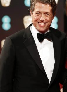 Hugh Grant 'trying to be a young father in an old man's body' at 60 | Hugh Grant 'trying to be a young father in an old man's body' at 60