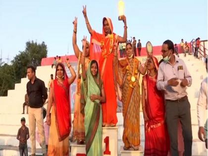 Women in Bhopal's village participate in 'Lota Daud' to send message against open defecation | Women in Bhopal's village participate in 'Lota Daud' to send message against open defecation