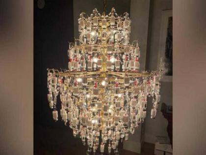 Nurse creates beautiful chandelier out of used covid vaccine bottles | Nurse creates beautiful chandelier out of used covid vaccine bottles