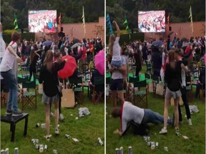 the person fell from the table while dancing ignored everyone and did the dance again read funny caption   डांस करते-करते अचानक टेबल से गिरा शख्स , फिर भी अपनी मौज में ऐसे नाचता रहा , वीडियो वायरल