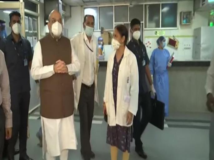 Amit Shah and Arvind Kejriwal visit biggest COVID-19 centre in Delhi | गृह मंत्री अमित शाह ने दिल्ली में 10 हजार बिस्तरों वाले कोविड देखभाल केन्द्र का किया दौरा, सीएम केजरीवाल भी थे मौजूद