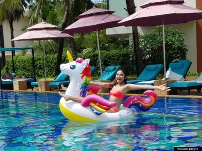 PHOTOS: actress Donal Bisht glam stunning pictures swimming pool images viral see pics   PHOTOS: स्विमिंग पूल में ग्लैमरस अंदाज में नजर आईं डोनल बिष्ट, देखें वायरल तस्वीरें   Lokmat News Hindi
