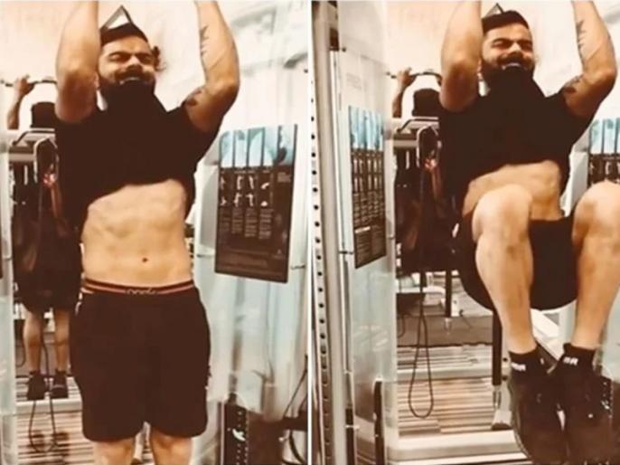 Indian captain Virat Kohli flexes eight-pack abs in workout video | विराट कोहली ने दांतों में टी-शर्ट फंसाकर दिखाए 8 पैक एब्स, शेयर किया वर्कआउट का वीडियो