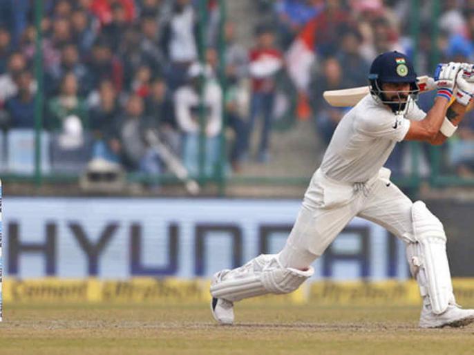 India vs Bangladesh, 1st Test: virat kohli fan on pitch during match | IND vs BAN, 1st Test: सुरक्षा घेरा तोड़कर विराट कोहली से मिलने पहुंचा फैन, पुलिस ने हिरासत में लिया