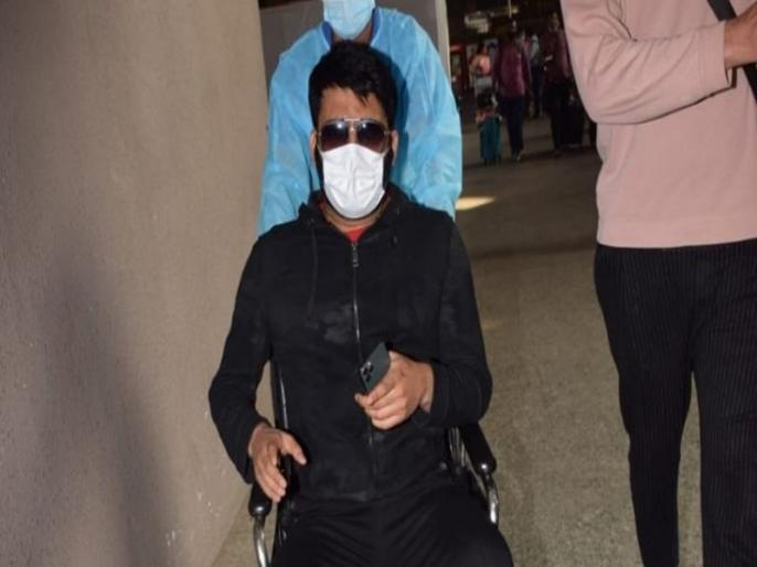 Wheelchair Bound Kapil Sharma Turns Abusive as He Gets Surrounded by Photographers Watch Video | एयरपोर्ट पर फोटोग्राफर्स को गालियां देते नजर आए कपिल शर्मा, वायरल वीडियो देख ट्रोल कर रहे फैंस