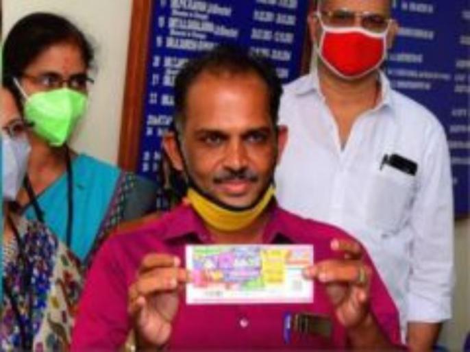 Crorepati Overnight Unsold Lottery Ticket Worth Rs 12 Crore Cashes In For Kerala Lottery Vendor | लॉटरी बेचकर भरता था परिवार का पेट, नहीं बिकने से हो गया था परेशान, खुद ही स्क्रैच किया और रातोंरात करोड़पति बन गया यह शख्स