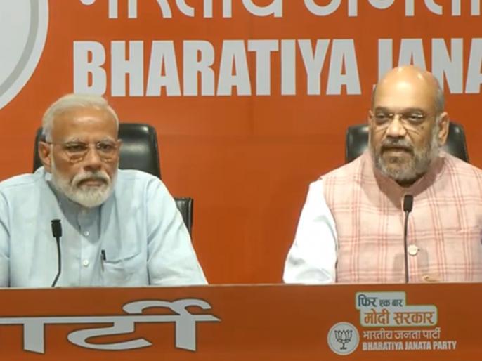 PM Narendra Modi First Press Conference along with BJP Chief Amit Shah | प्रधानमंत्री नरेंद्र मोदी की पहली 'प्रेस कांफ्रेंस': अमित शाह ने दिए पत्रकारों के सवालों के जवाब, पीएम बने रहे मूकसाक्षी