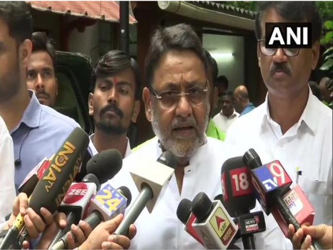 Mumbai migrant round accusations continue Maharashtra minister Nawab Malik said arrested person member of NCP | Mumbai migrant crisis: आरोप का दौर जारी,महाराष्ट्र के मंत्री नवाब मलिक बोले-गिरफ्तार व्यक्ति एनसीपीका सदस्य नहीं