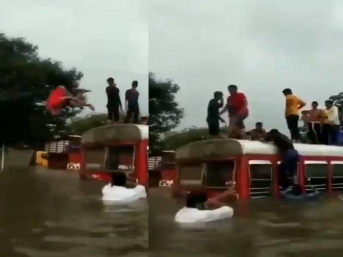 mumbai heavy rain Water logging people swing in this watch viral video | मुंबई में बारिश से सड़कें बनीं नदी, लोग स्विमिंग करते आए नजर, देखें वायरल वीडियो