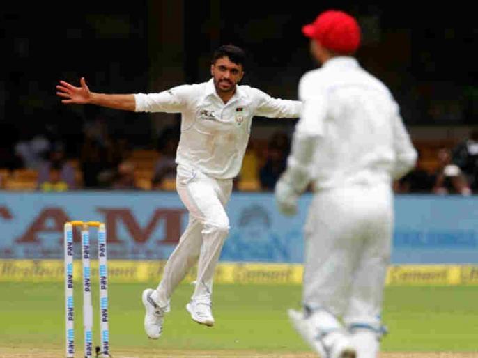 IND vs AFG: Yamin Ahmadzai becomes first bowler to take test wicket for Afghanistan | IND vs AFG: इस अफगानी गेंदबाज ने धवन को आउट कर किया कमाल, रिकॉर्ड बुक में दर्ज कराया अपना नाम